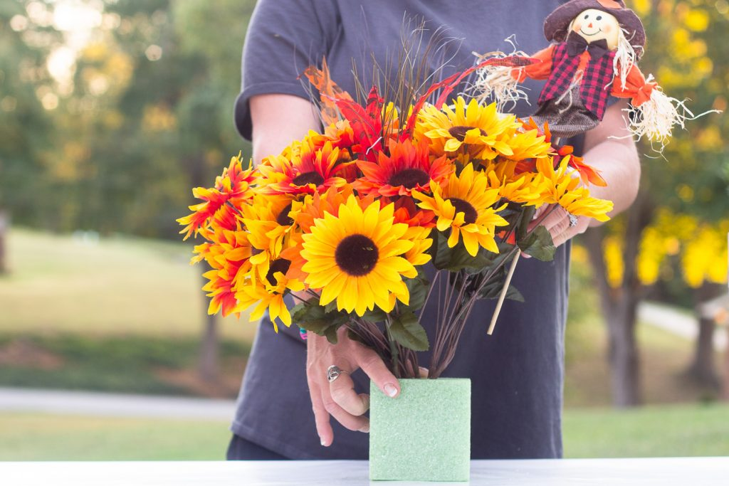 arranging fall flowers for fall centerpiece